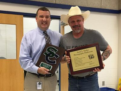 Mr. Pflugrath presents Mr. Saylor with a SC plaque.