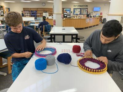 "Students knitting for ""Hats for Some"""