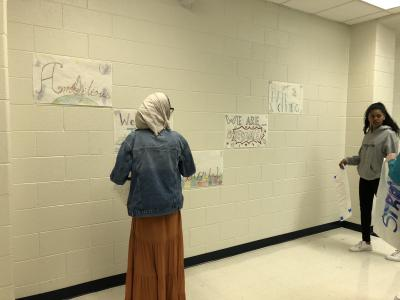 Students posting Posters
